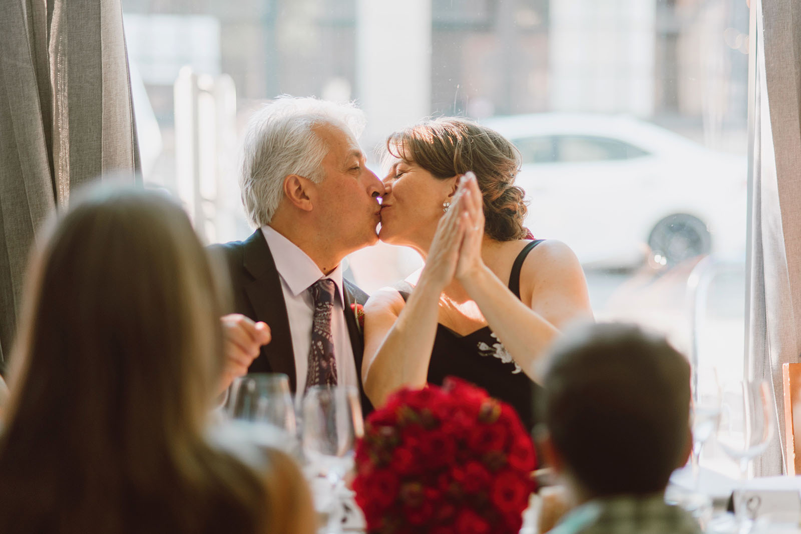 Bride and Groom kissing at Trattoria Gallo Nero