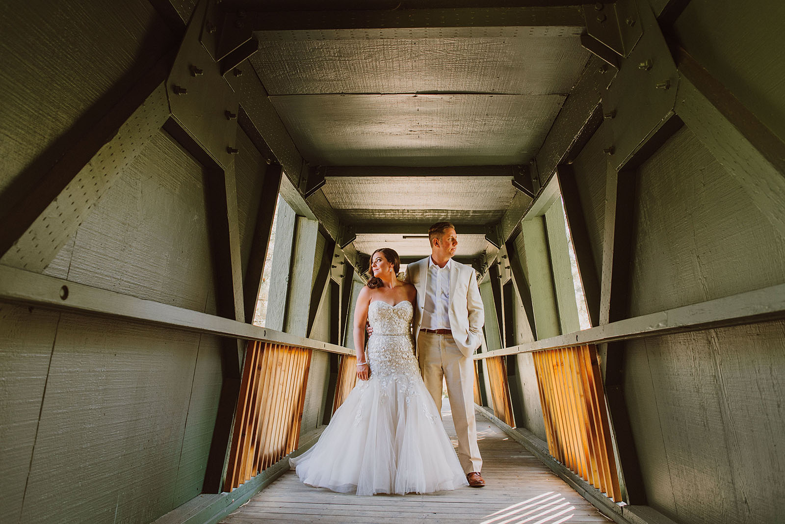 Bride and Groom posing in a covered bridge at their Incline Village Wedding in North Lake Tahoe