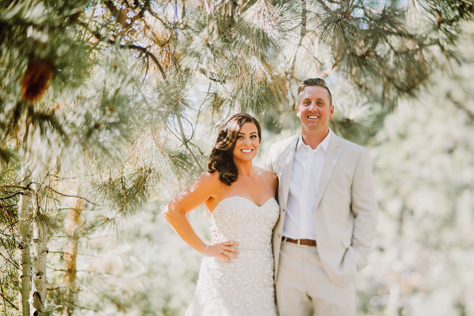 Bride and Groom smiling in the pine trees at their Incline Village wedding