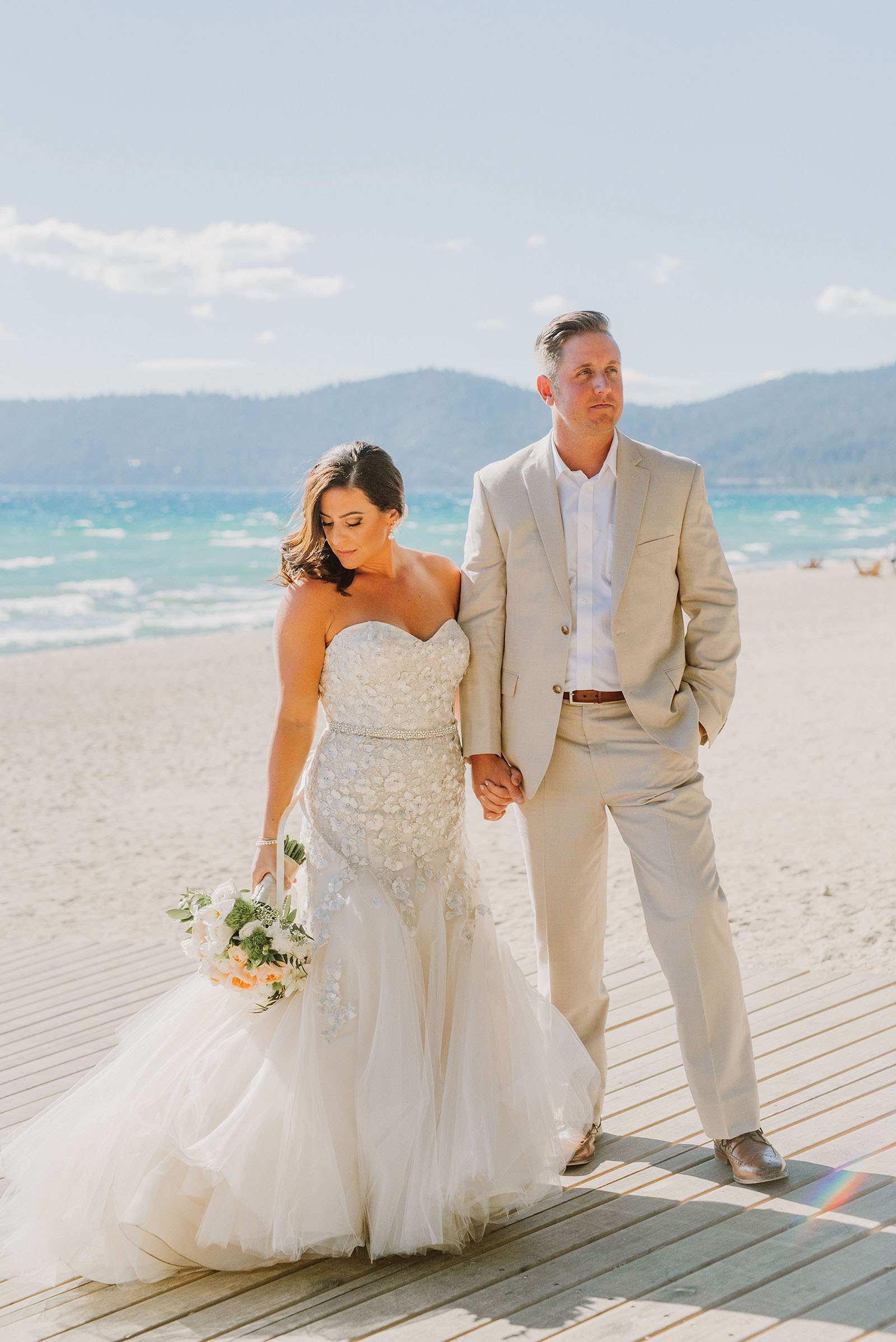 Bride and Groom posing on the North Lake Tahoe beach at an Incline Village wedding