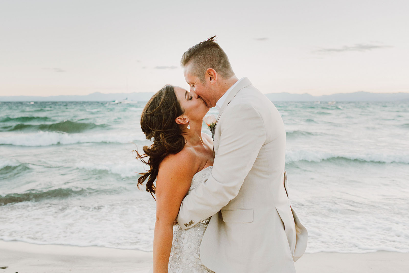 Bride and Groom kissing on the North Lake Tahoe beach at an Incline Village Wedding