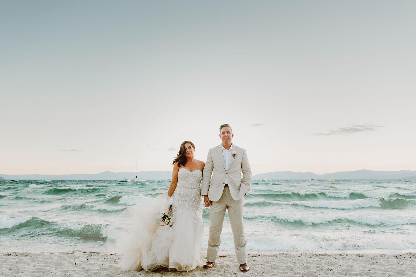 Waves crashing behind Bride and Groom at an Incline Village wedding