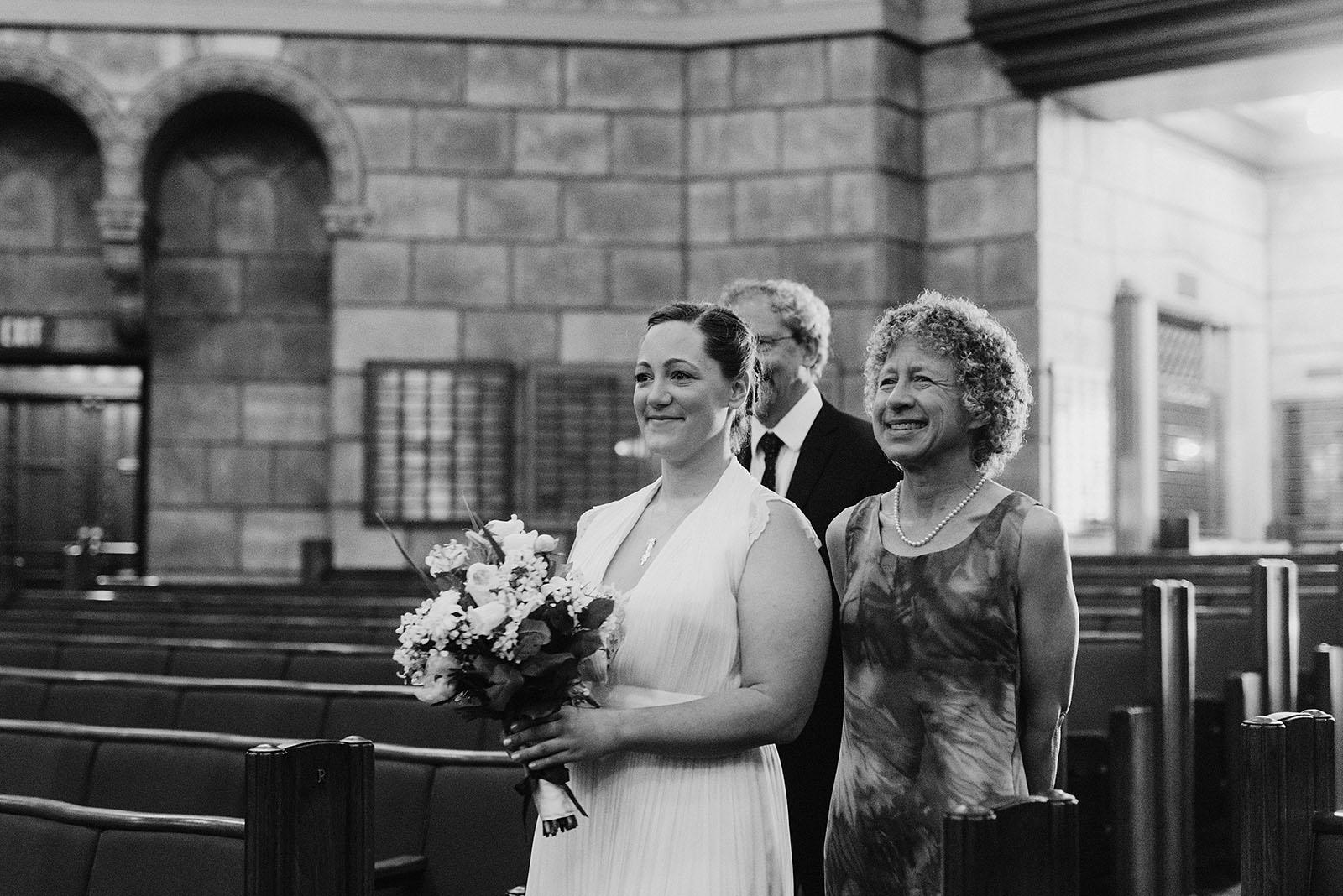 Bride walking down the aisle of a Congregation Beth Israel wedding