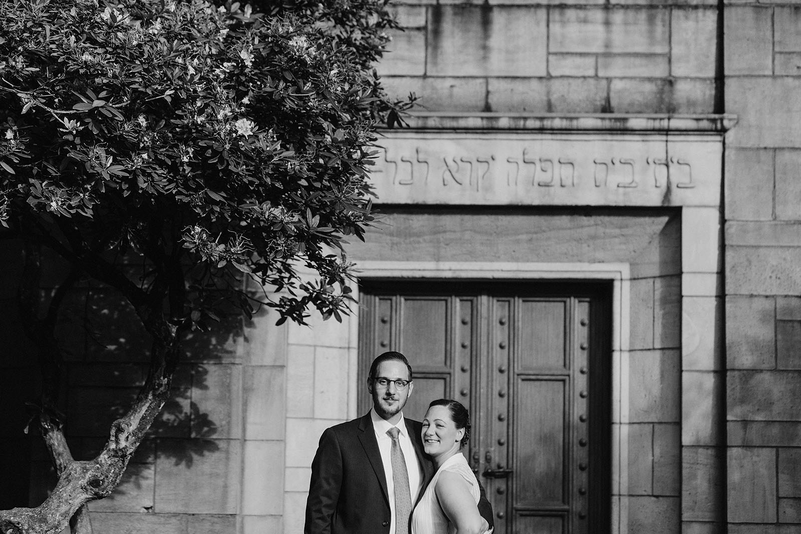 Bride and Groom posing outside of their Congregation Beth Israel wedding
