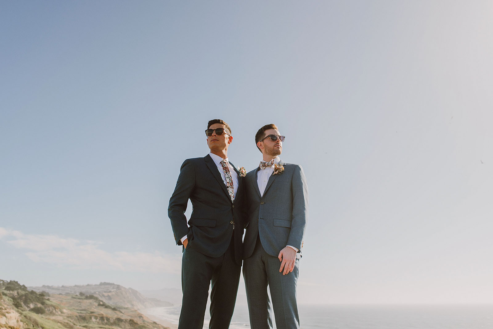Grooms posing on the cliffs at Fort Funston - Foreign Cinema Wedding