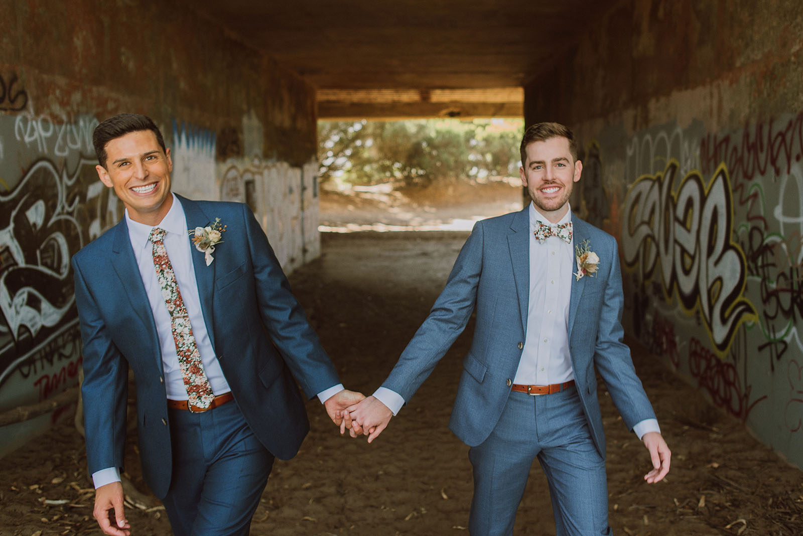 Grooms holding hands at Fort Funston - Foreign Cinema Wedding
