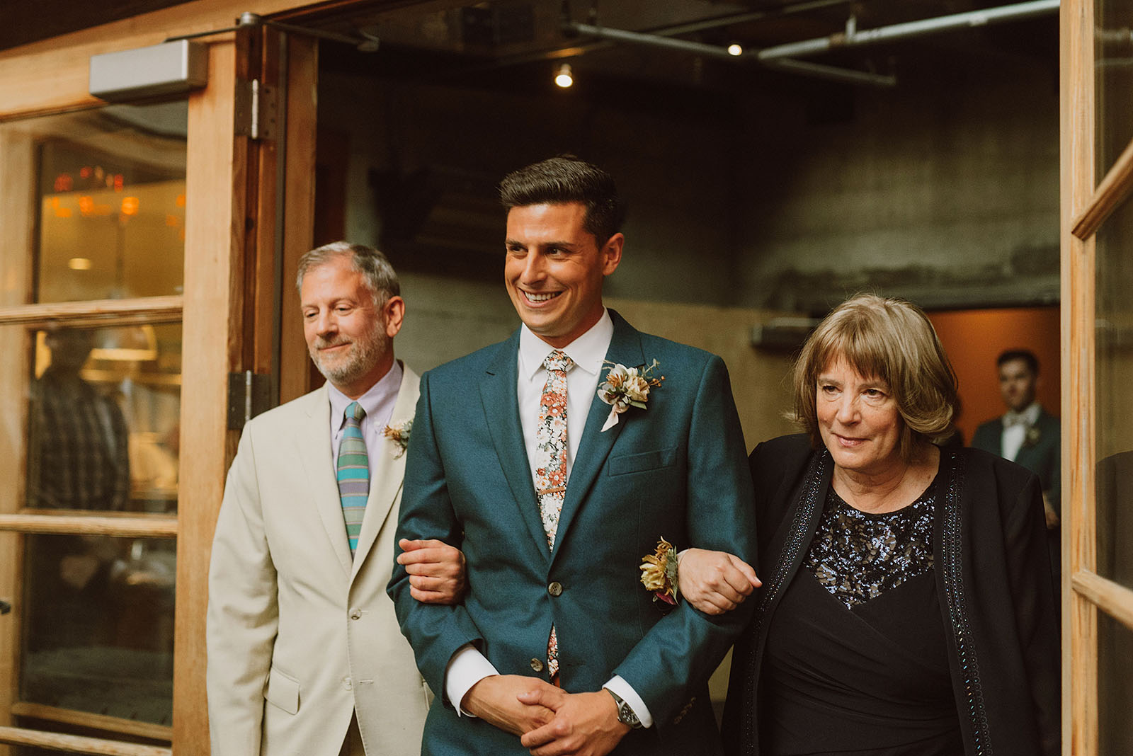 Groom walking down aisle with parents - Foreign Cinema Wedding