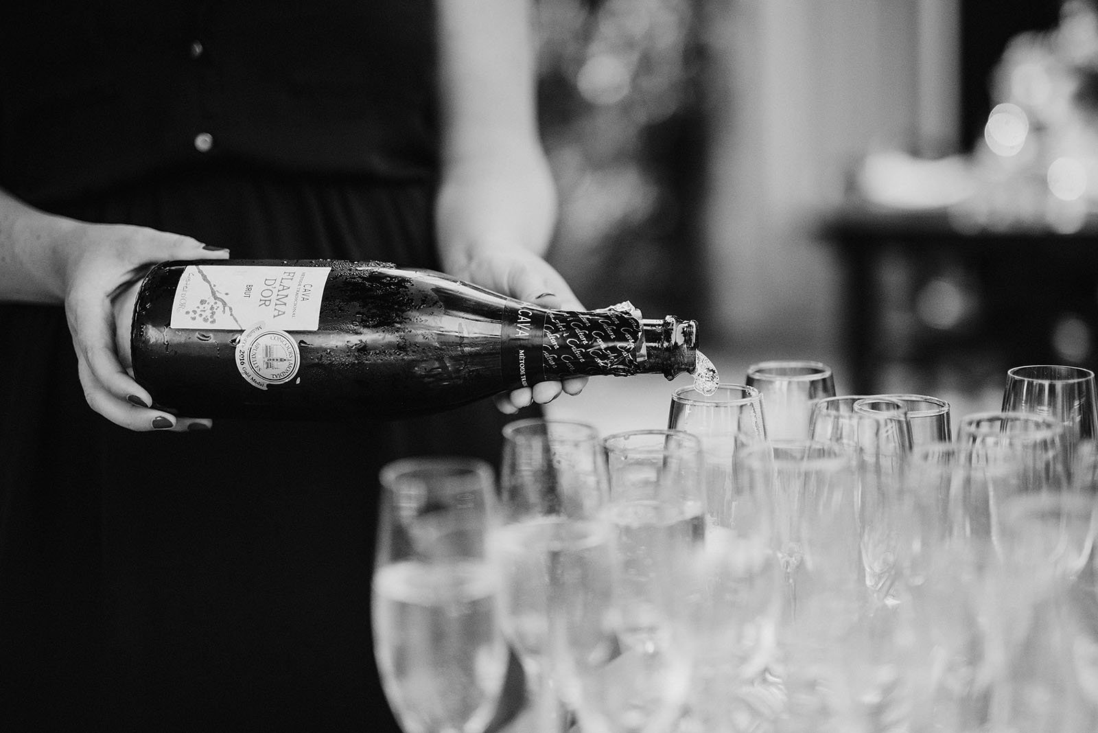 Hosts at Elder Hall pouring champagne at an intimate Ned Ludd wedding