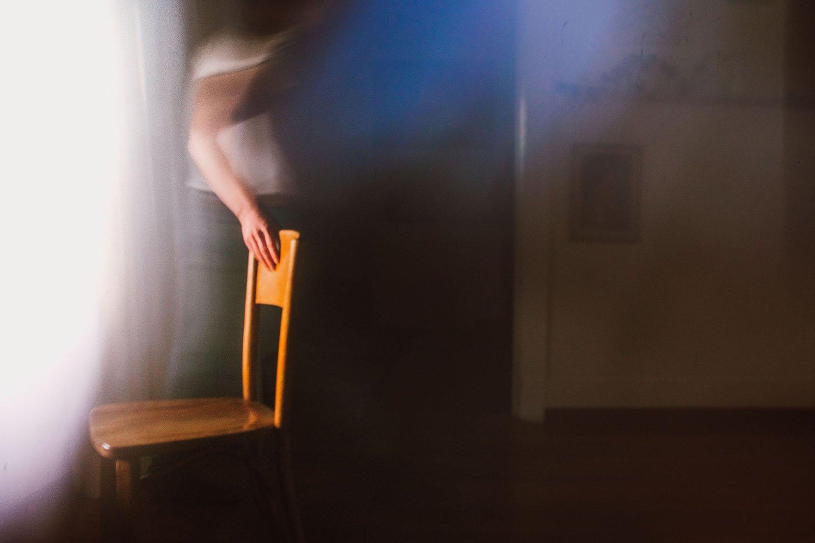 Ghostly photo of man moving chair - Portland Music Photographer
