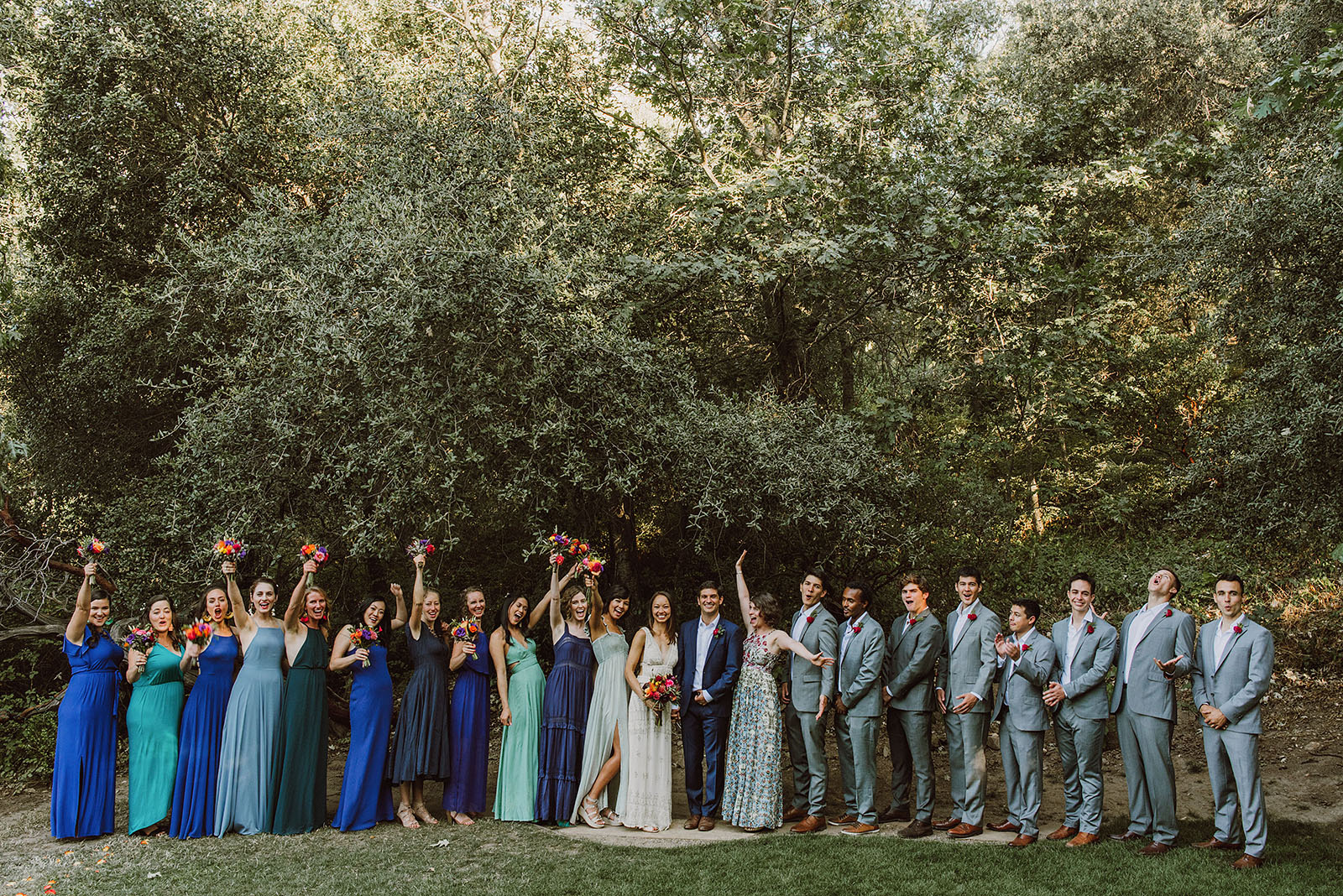 Group photo of couple and guests cheering at a Sacred Mountain Retreat Wedding