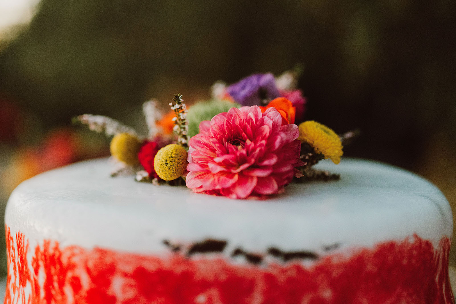 flowers on top of the cake at a Sacred Mountain Retreat Wedding