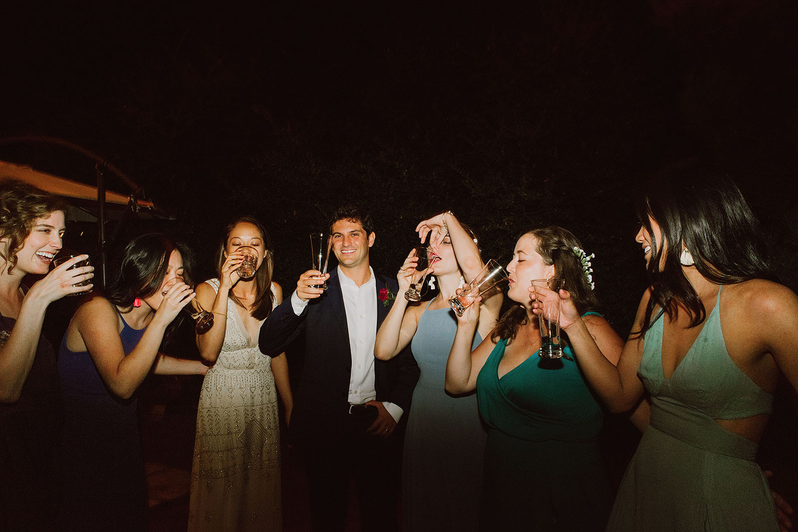 group photo of guests doing shots at a Sacred Mountain Retreat Wedding