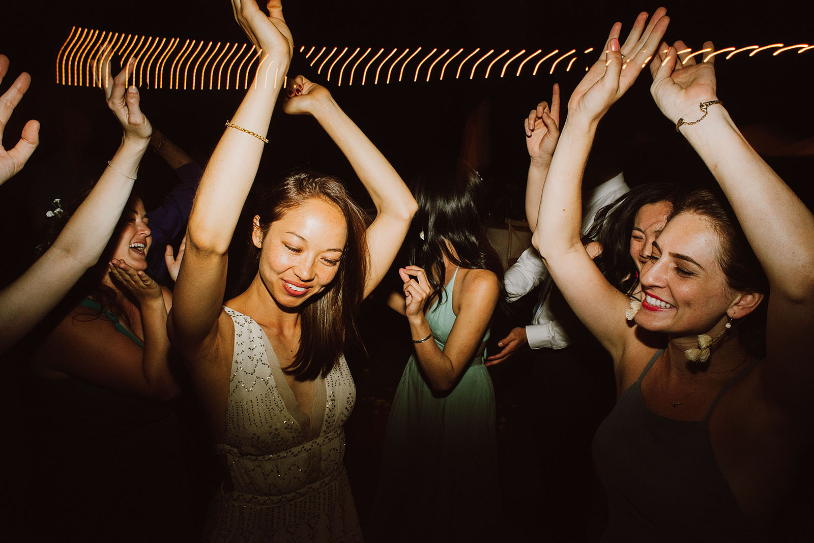 bride dancing with her bridesmaids at a Sacred Mountain Retreat Wedding