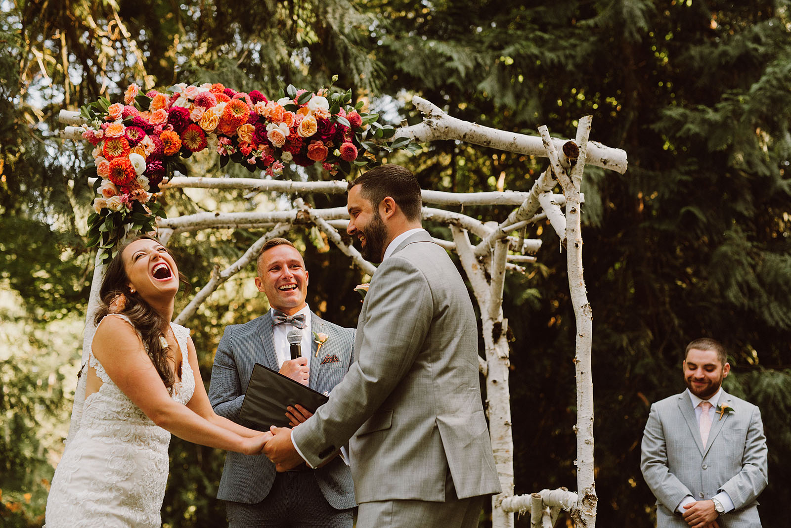 Bride laughing during the vows at a Cedarville Lodge Wedding in Gresham, OR
