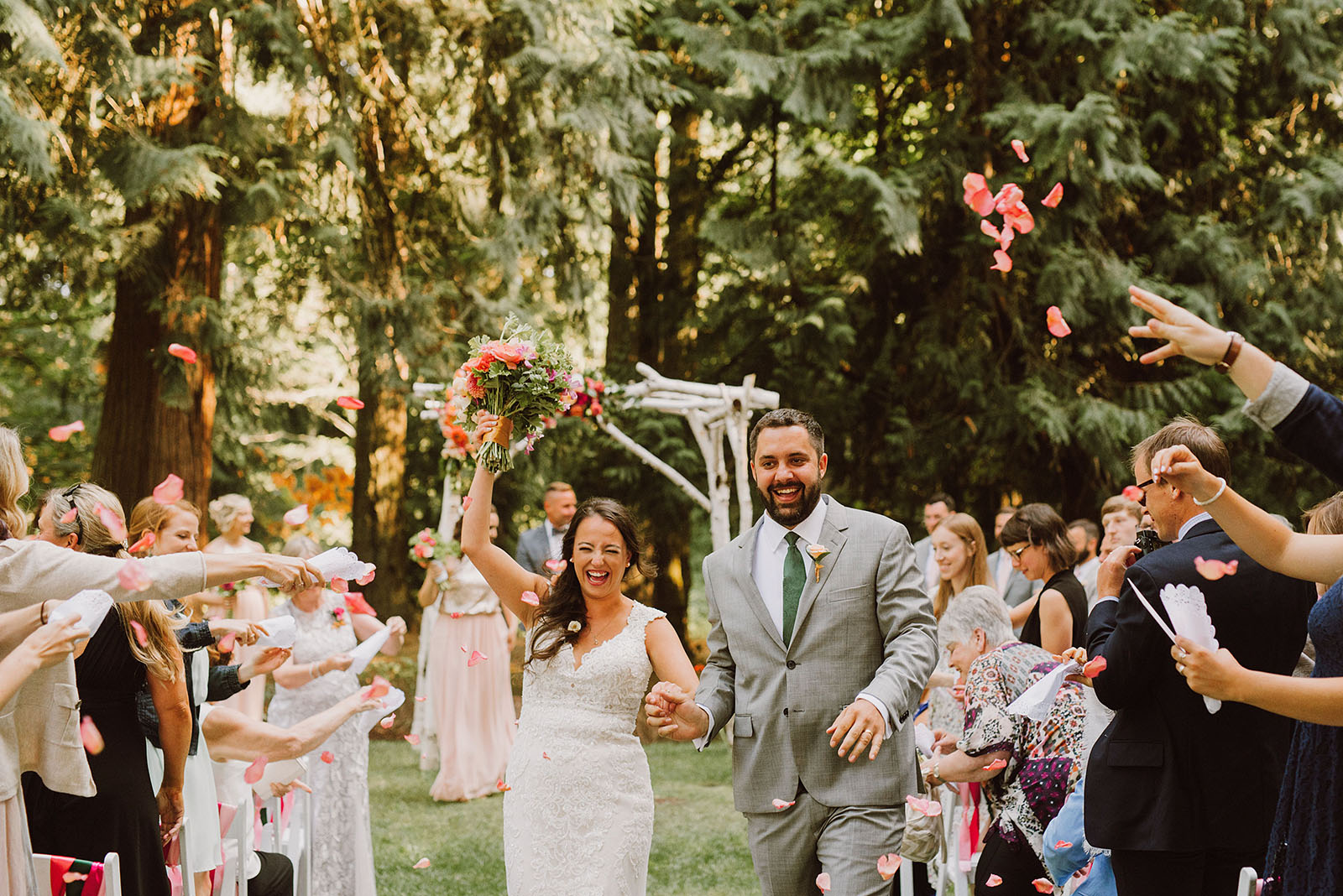 Bride and Groom being showered with flower petals at a Cedarville Lodge Wedding in Gresham, OR