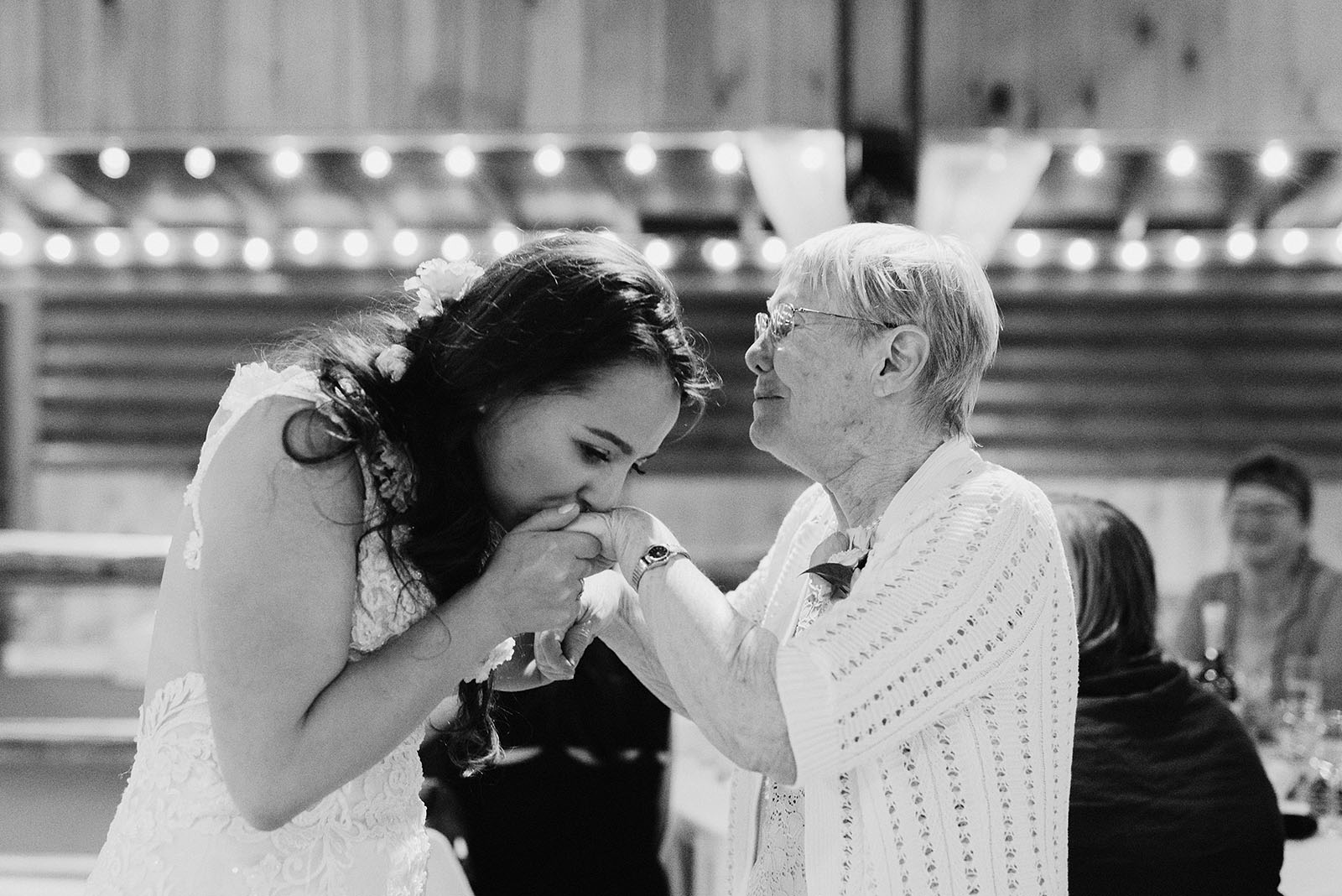 Bride kissing her grandmother during the toasts at a Cedarville Lodge Wedding