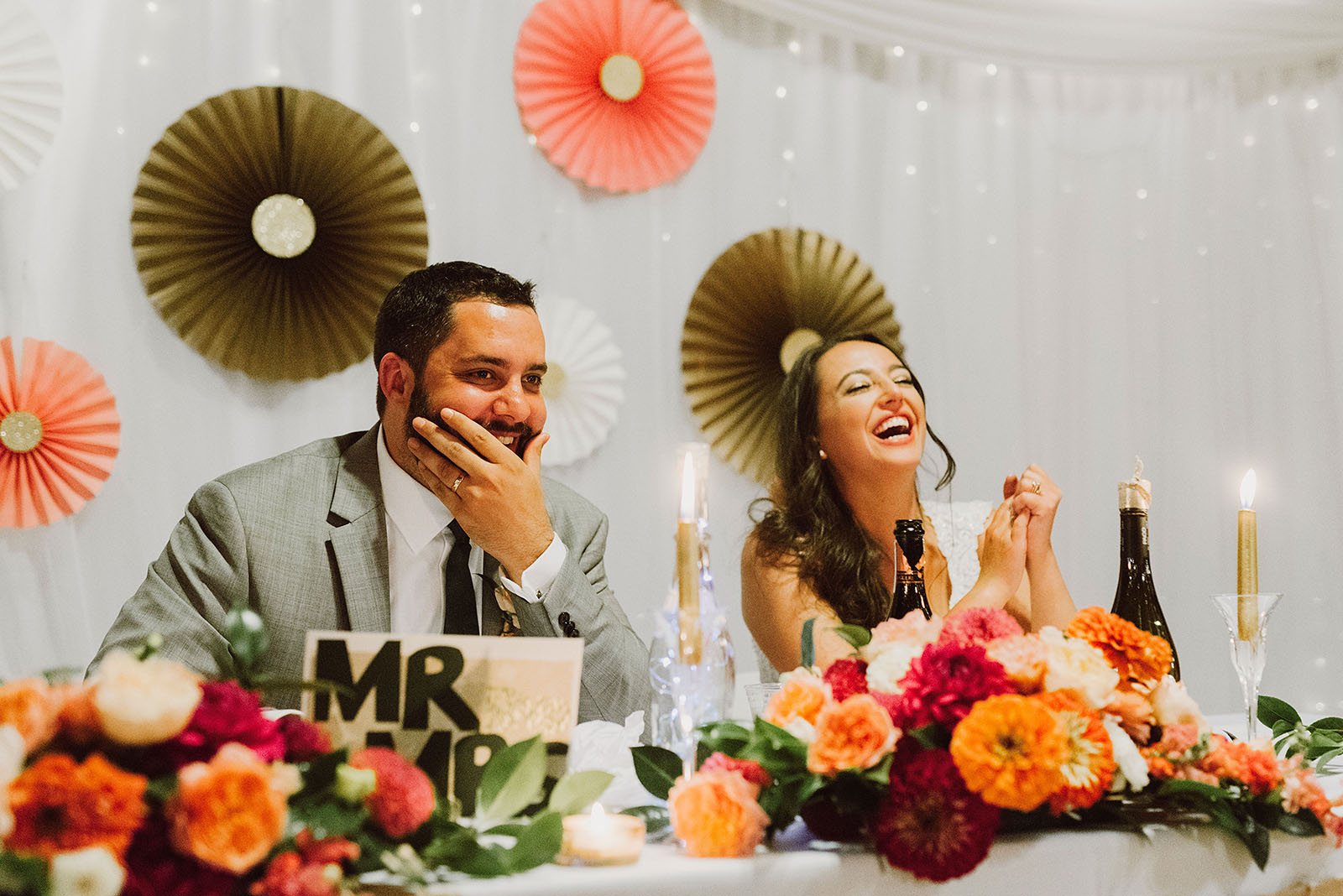 Bride and Groom laughing during the toasts at their Cedarville Lodge Wedding