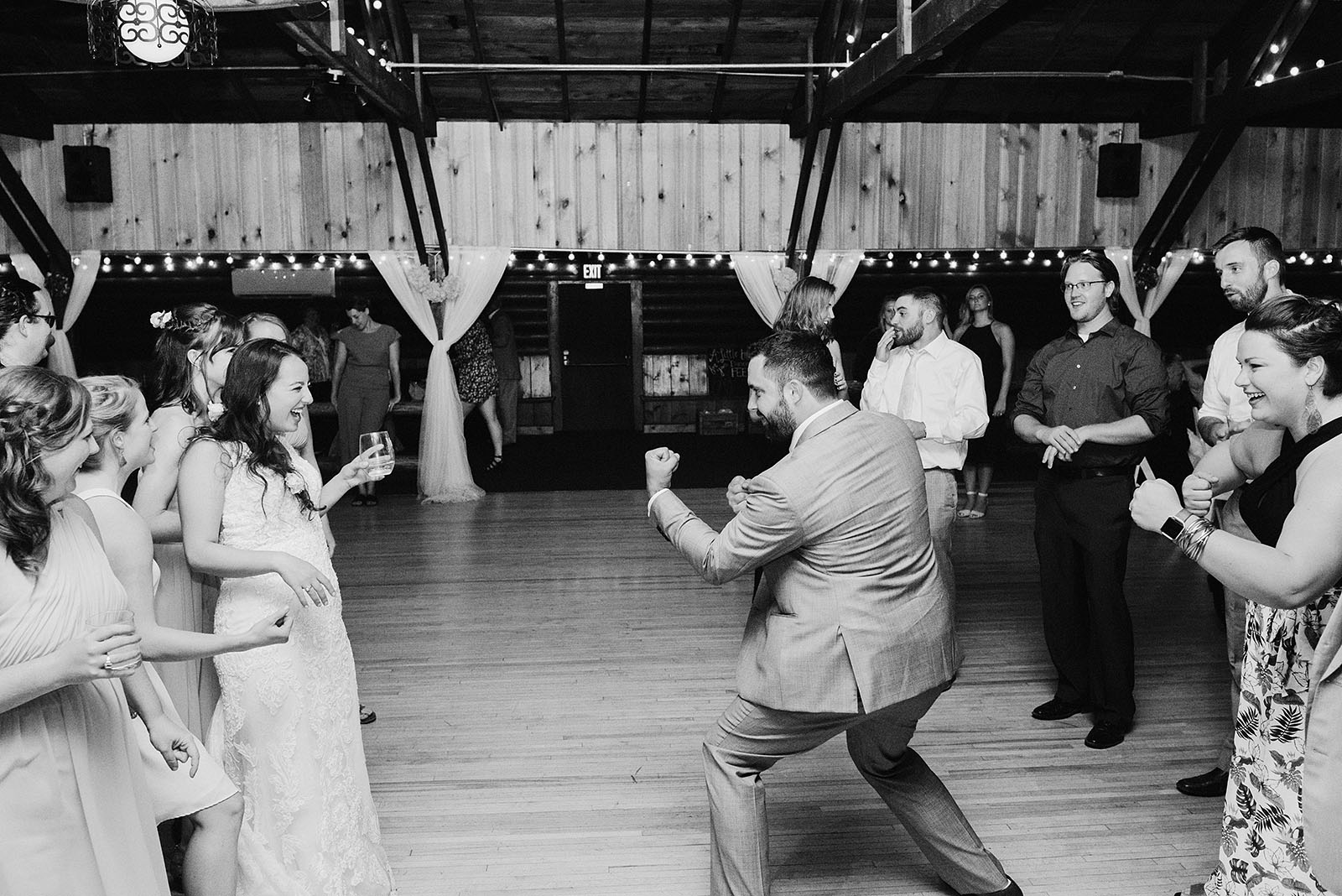 Bride and Groom dueling on the dance floor at their Cedarville Lodge Wedding reception