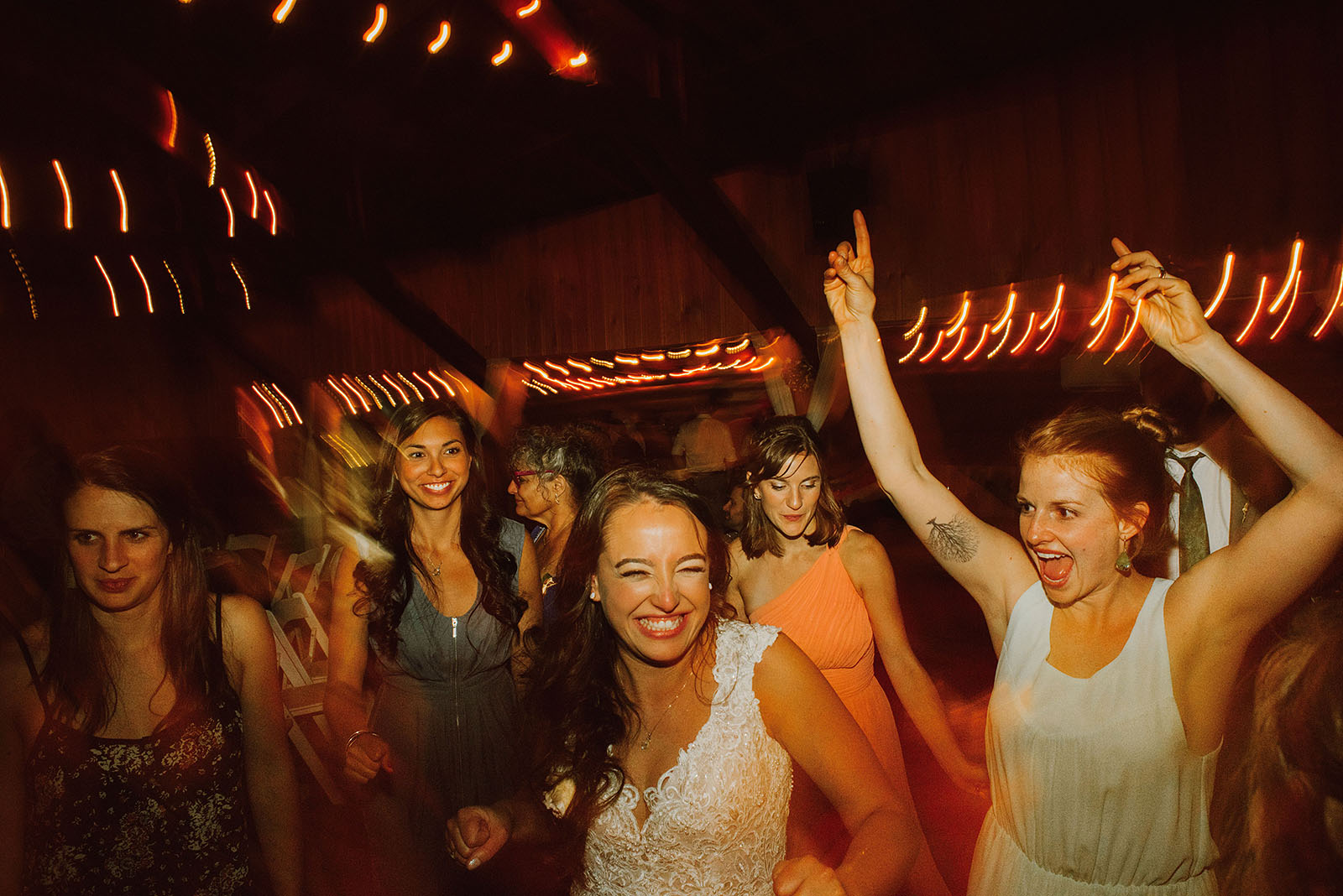 Guests partying on the dance floor at a Cedarville Lodge Wedding reception