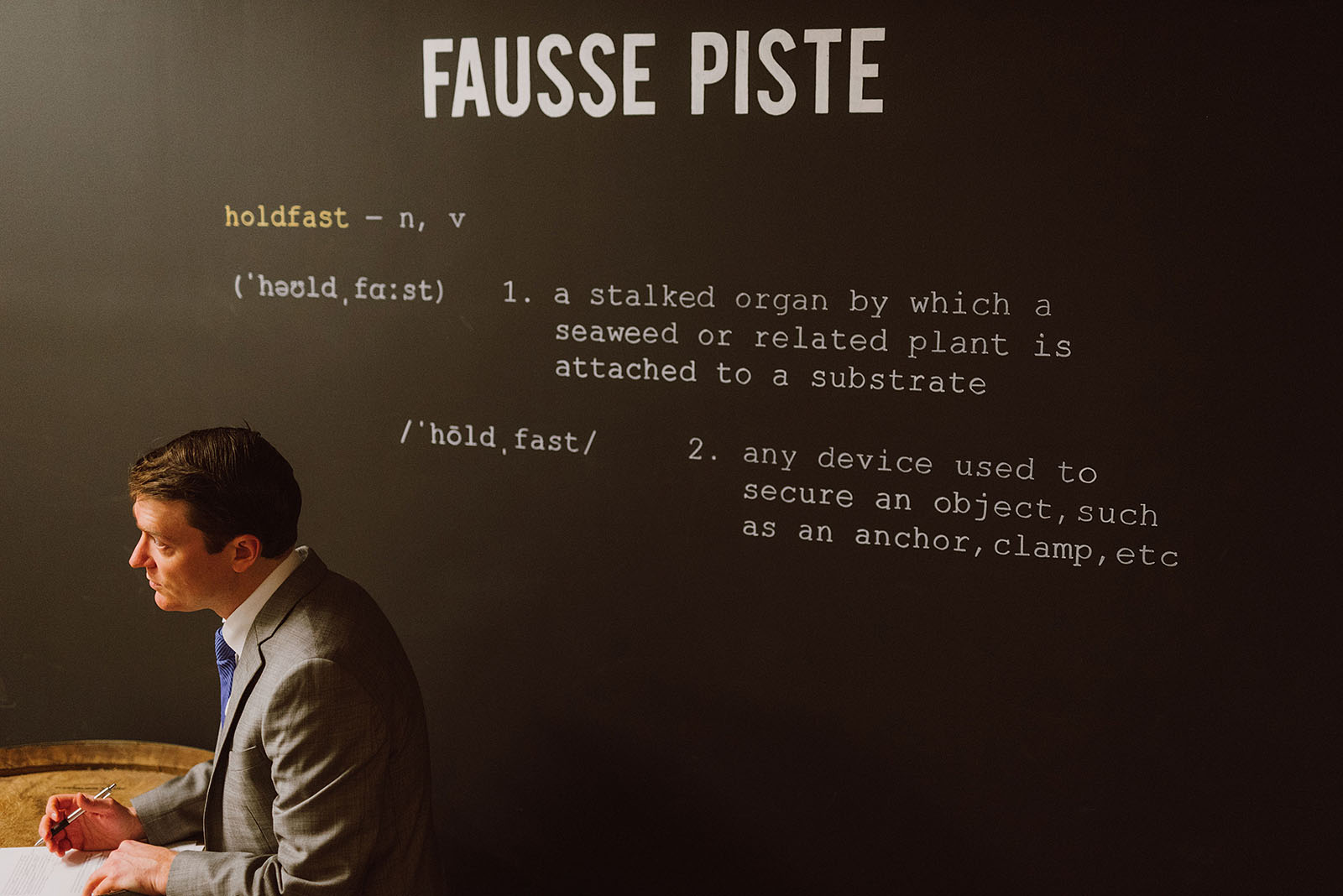 Groom writing vows in front of Fausse Piste - Intimate Restaurant Wedding in Portland, OR