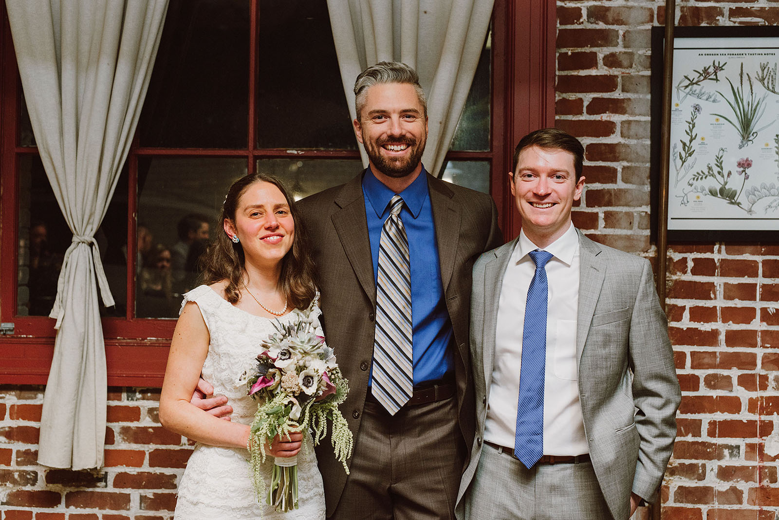 Portrait of bride and groom with their officiant at an Intimate Restaurant Wedding in Portland, OR
