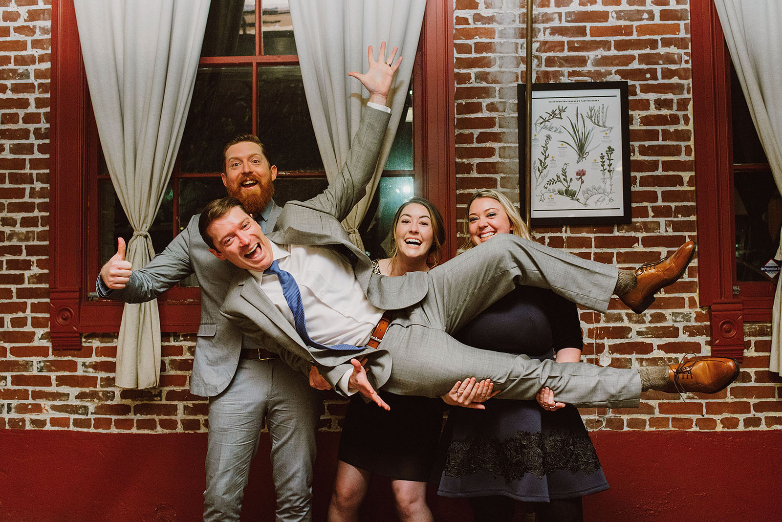 Silly portrait of the Groom and his siblings at an Intimate Restaurant Wedding in Portland, OR