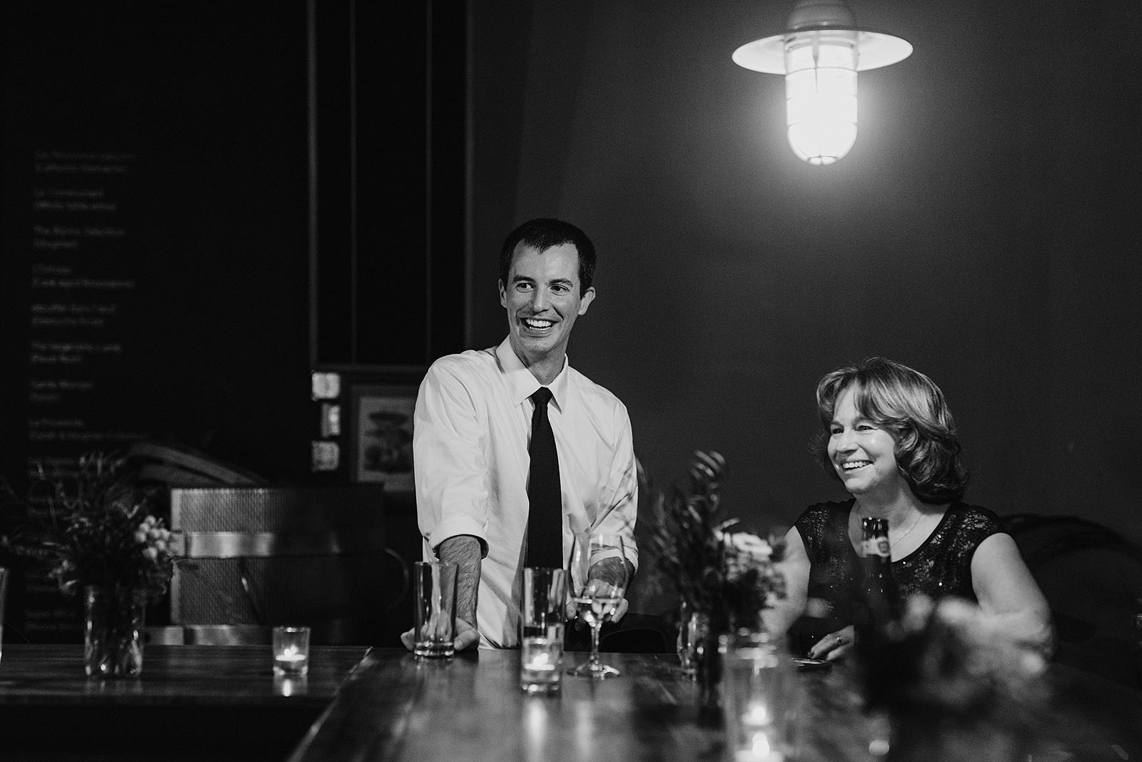 Mother of the groom laughing with guests at an Intimate Restaurant Wedding in Portland, OR