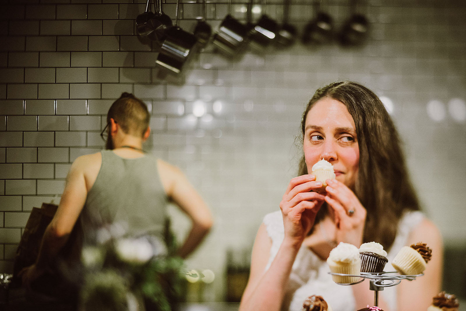 Bride sniffing a cupcake at her Intimate Restaurant Wedding in Portland, OR