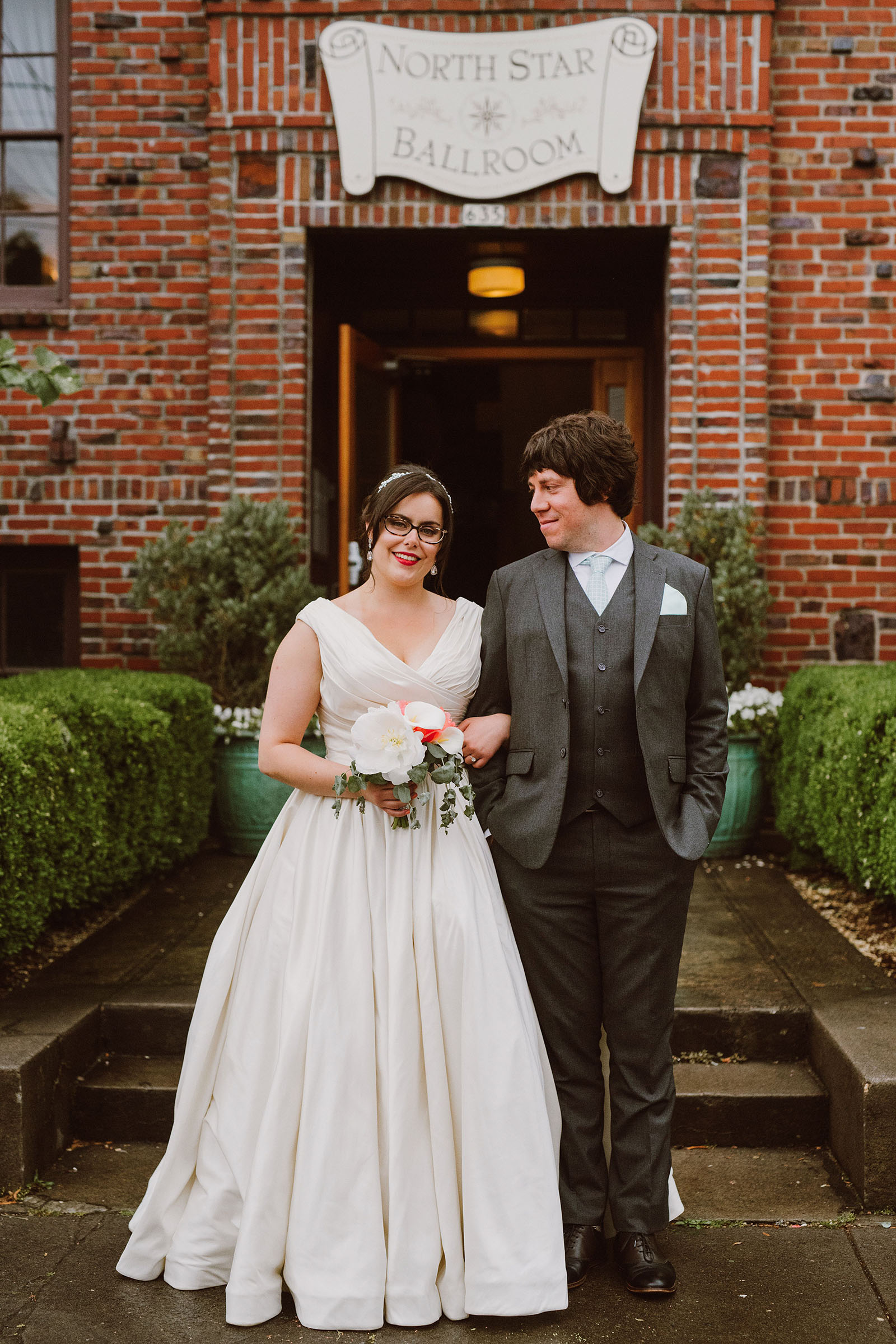 Portrait of Bride and Groom on front steps - Polaris Hall Wedding