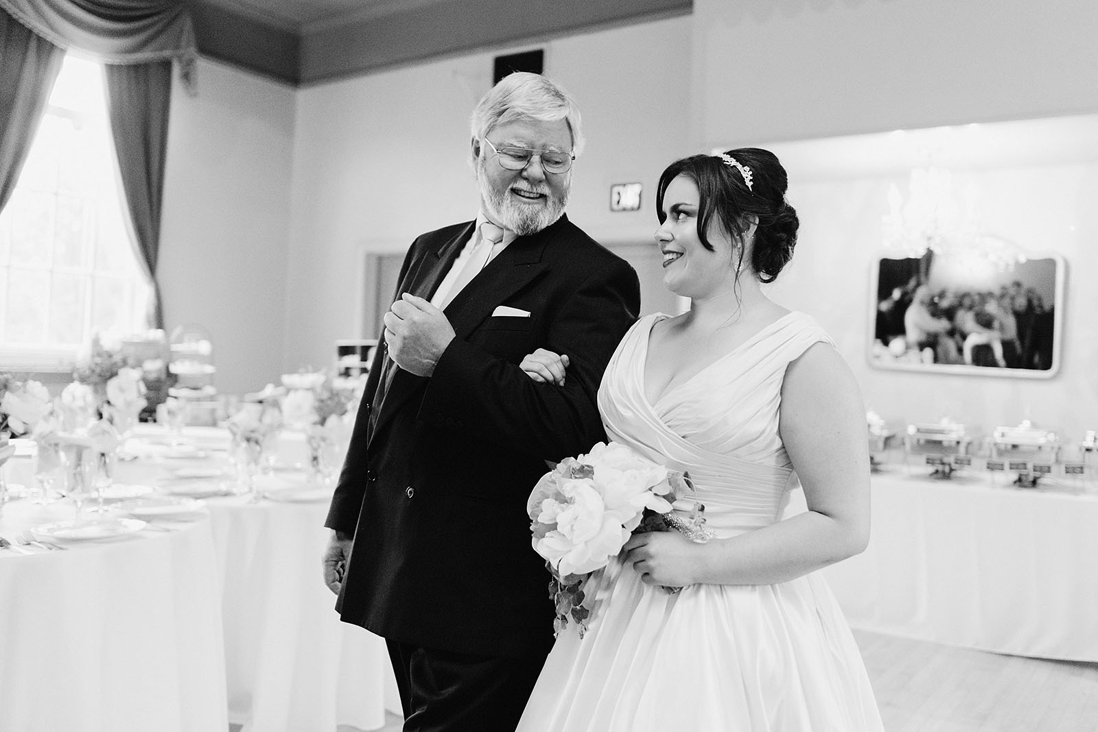 Father of the bride smiling while walking down the aisle - Polaris Hall Wedding