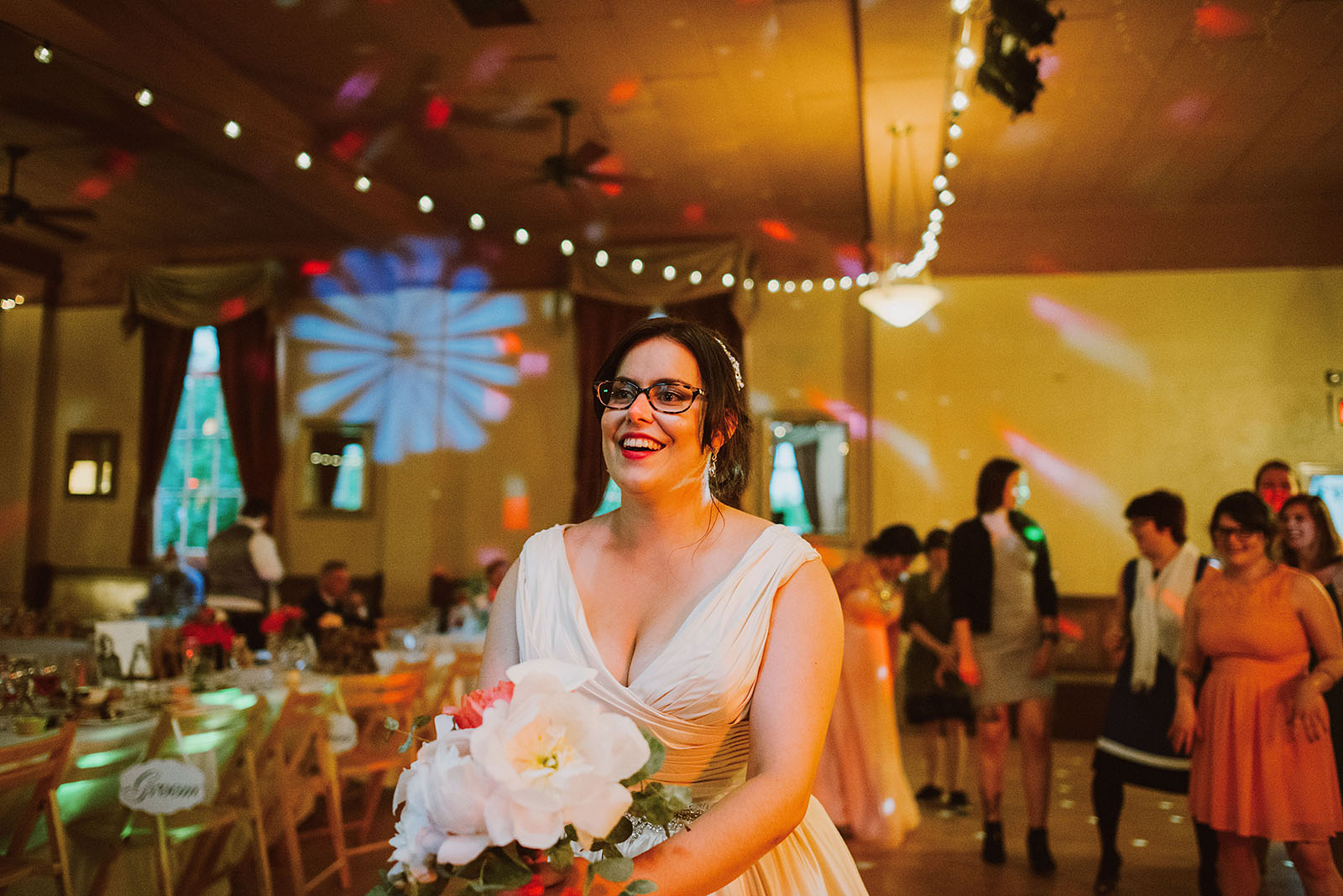 Bride tossing bouquet on the dance floor - Polaris Hall Wedding
