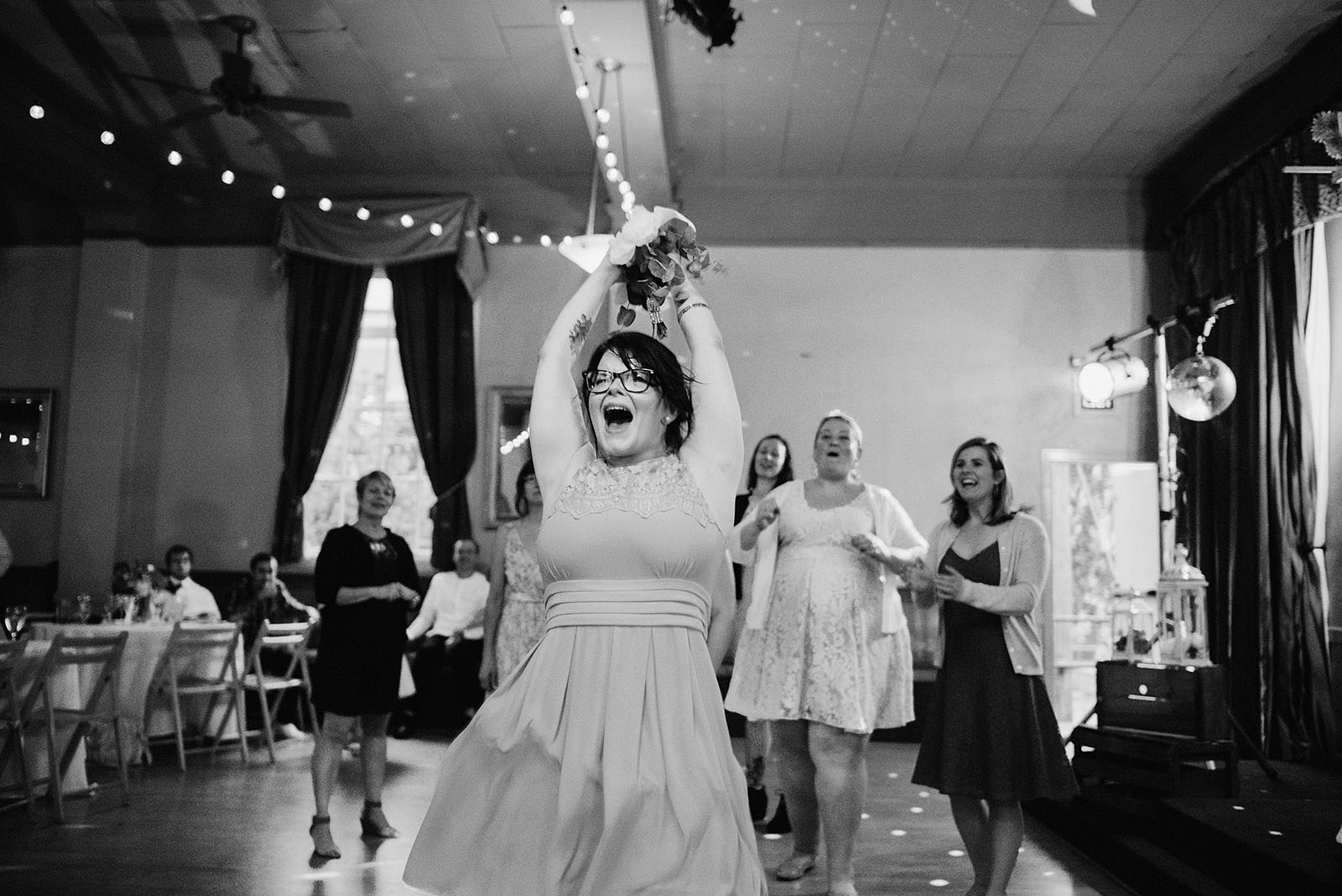Bride's sister catching the bouquet - Polaris Hall Wedding