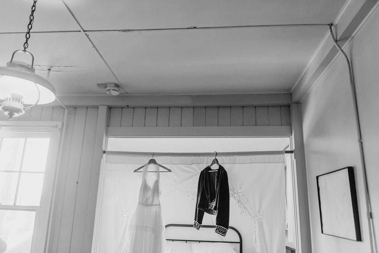 Bride's dress hanging in the suite at a SouWester Wedding in Seaview, WA