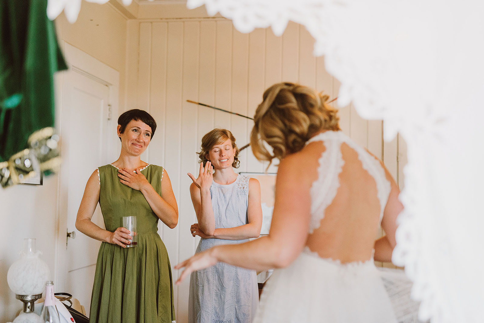 Bridesmaids watching the bride get dressed at a SouWester Wedding in Seaview, WA