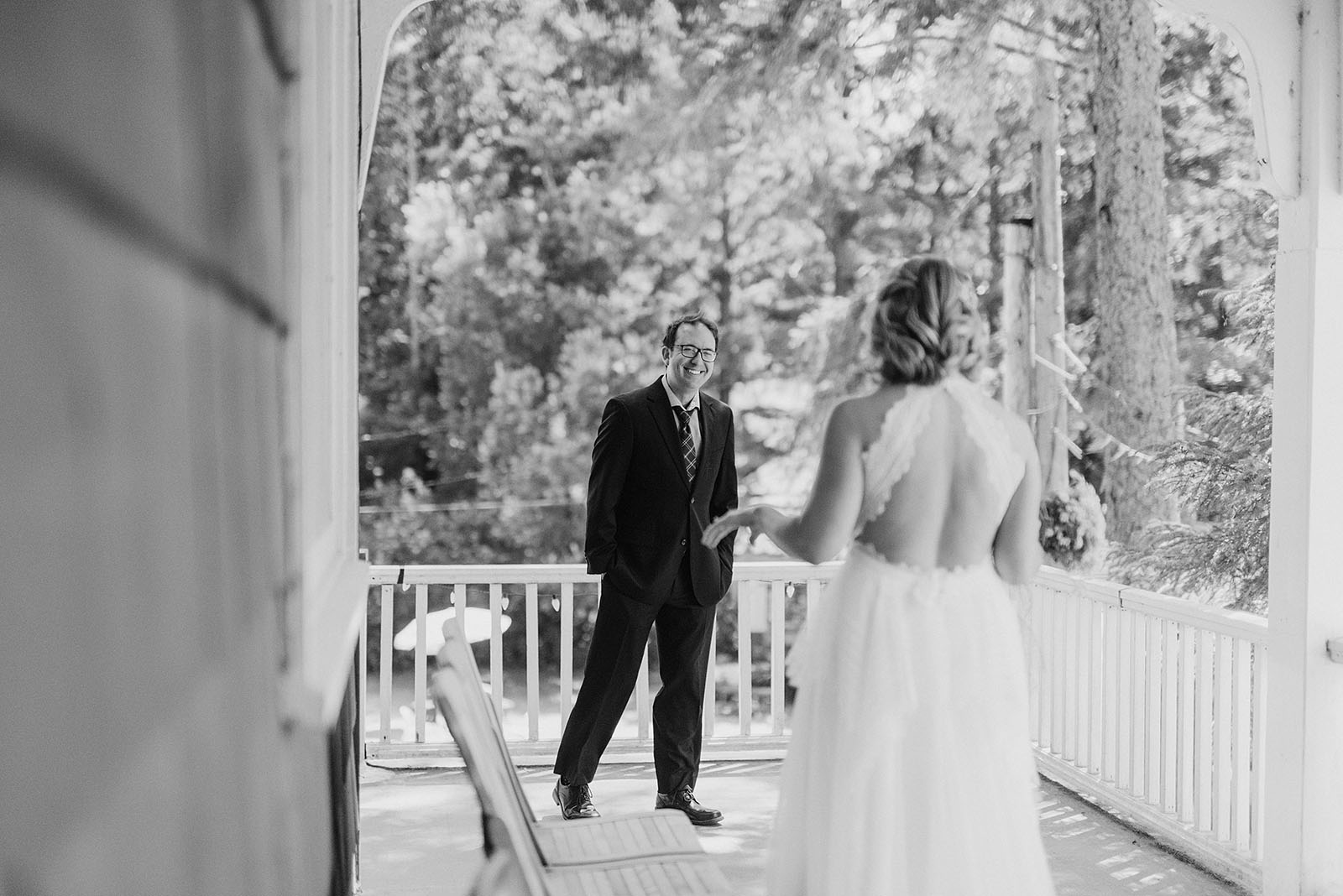 Groom's First Look with the Bride on the balcony at a SouWester Wedding in Seaview, WA