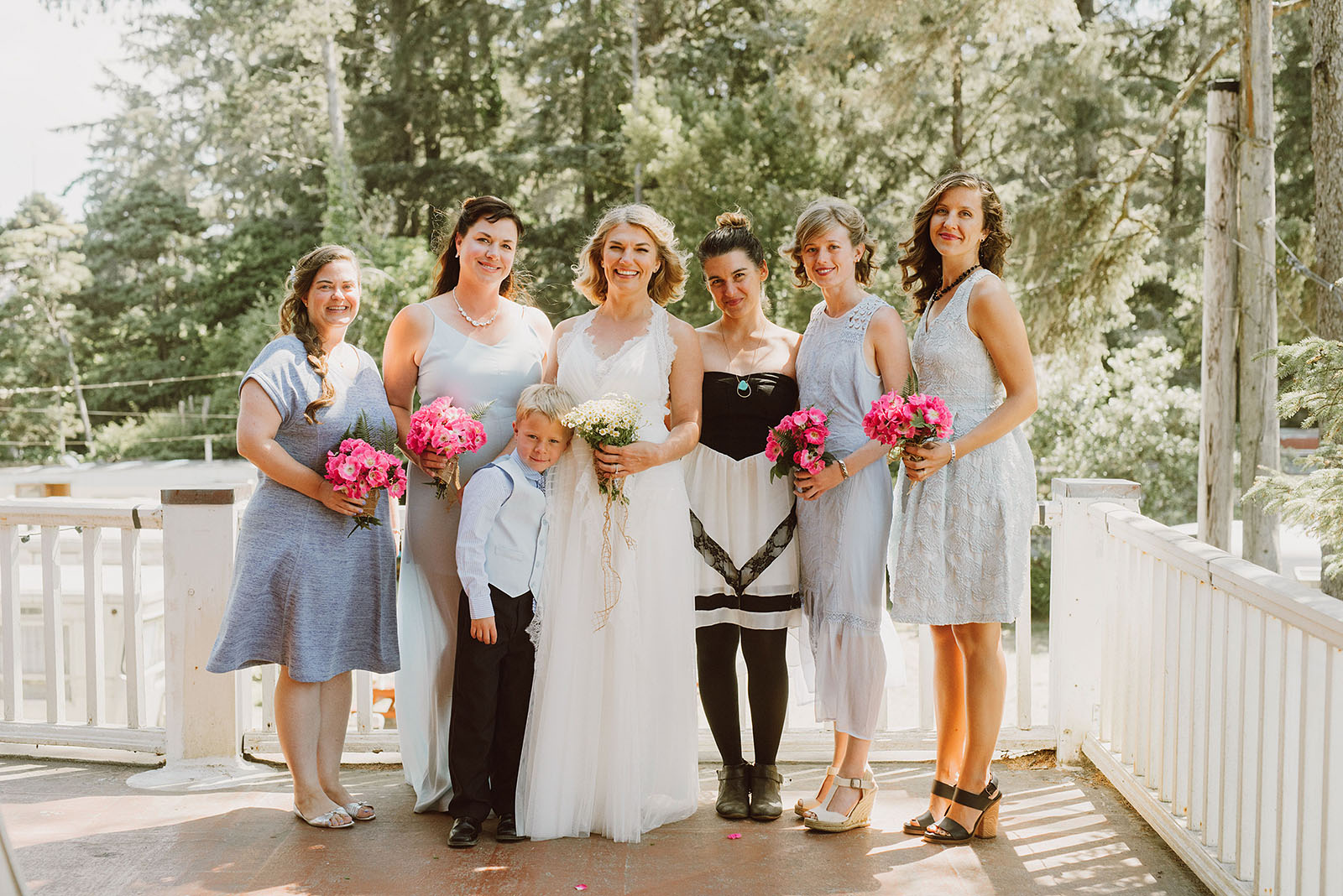 Bride with her bridesmaids on the balcony at a SouWester Wedding in Seaview, WA