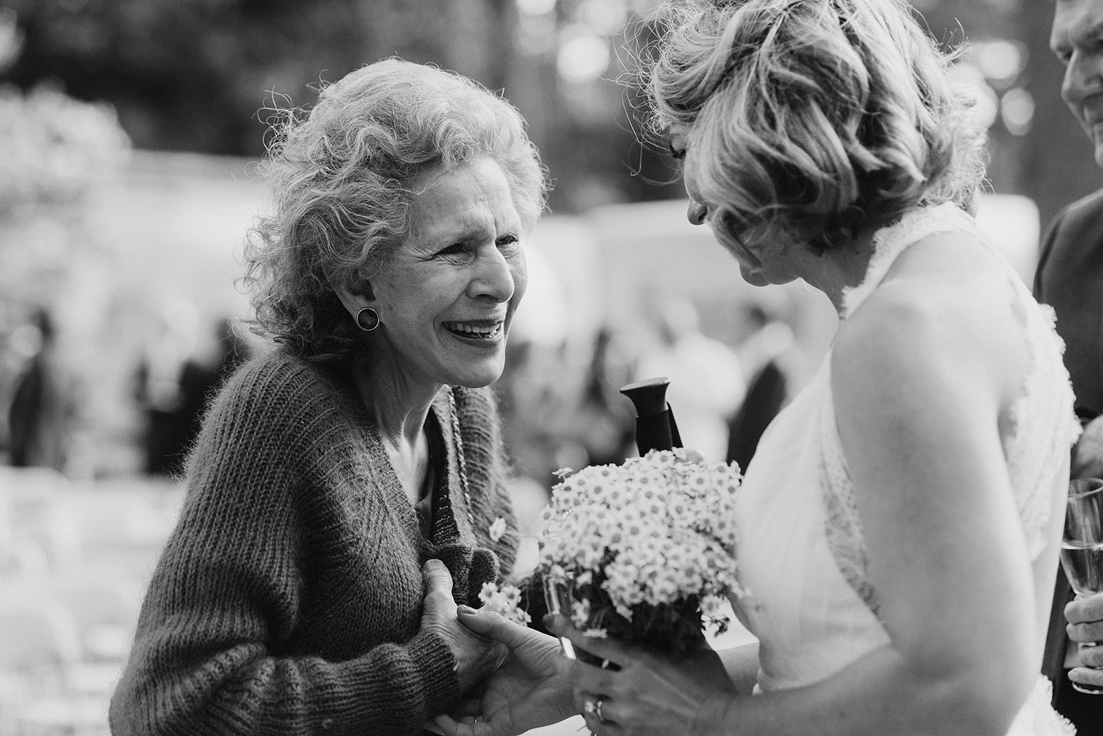 Bride talking with Groom's grandmother at a SouWester Wedding in Seaview, WA