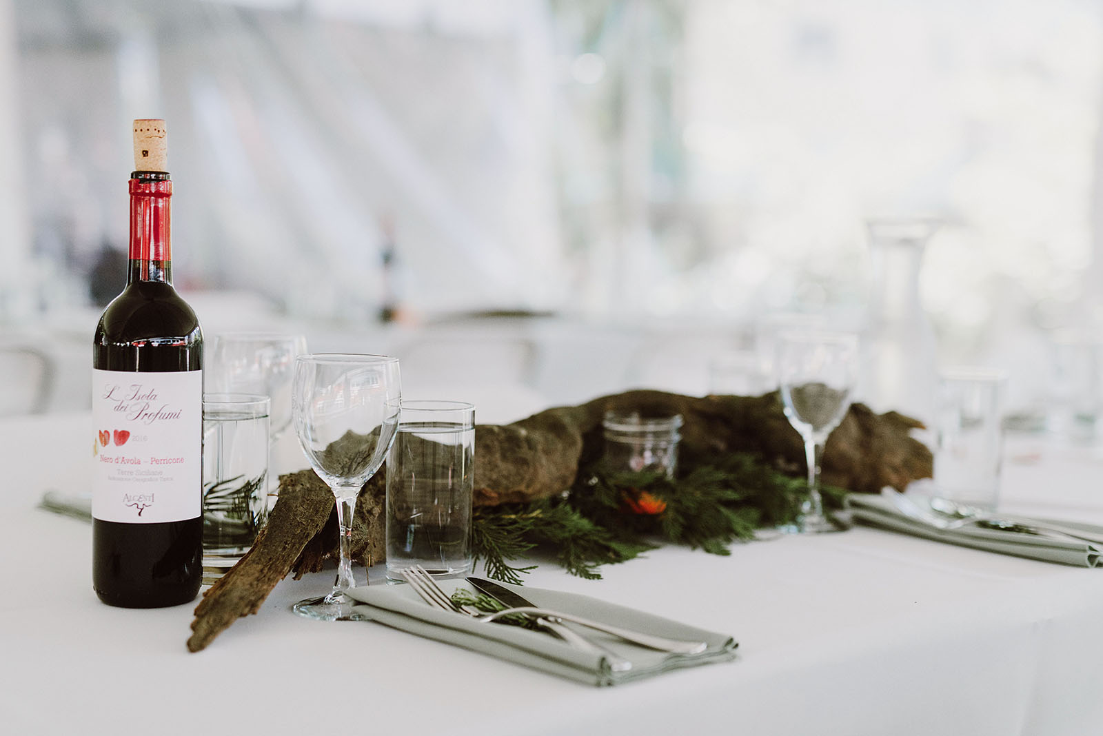Driftwood table centerpieces at a SouWester Wedding in Seaview, WA