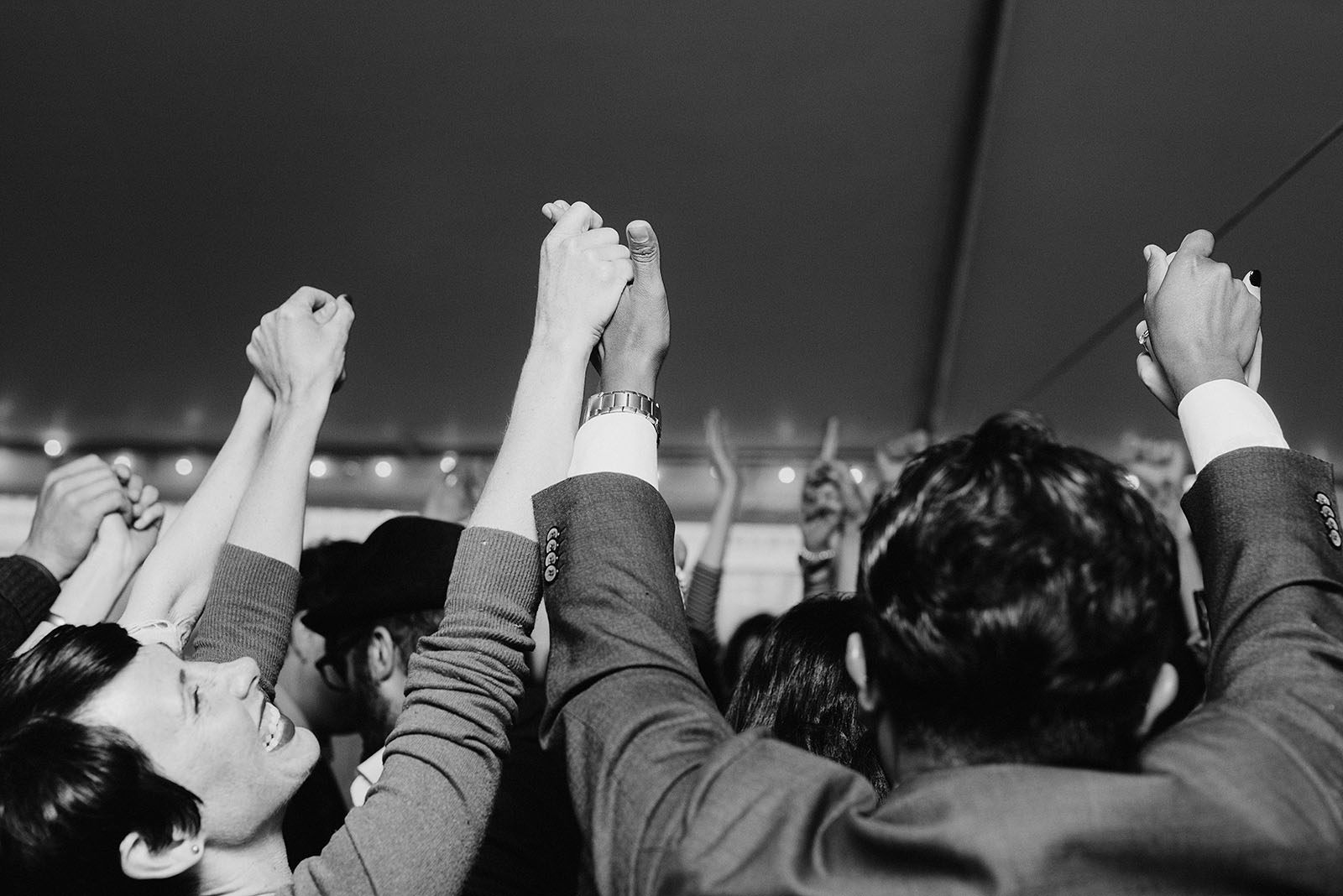 Guests holding hands during the hora at a SouWester Wedding in Seaview, WA