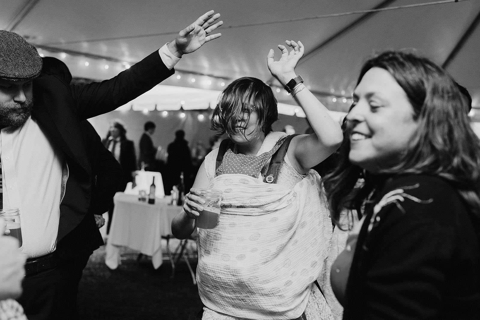 Guests dancing and drinking at a SouWester Wedding in Seaview, WA