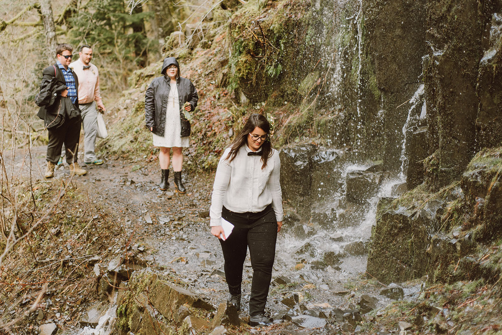Guests hiking the Wahclella Falls trail at a Portland waterfall elopement