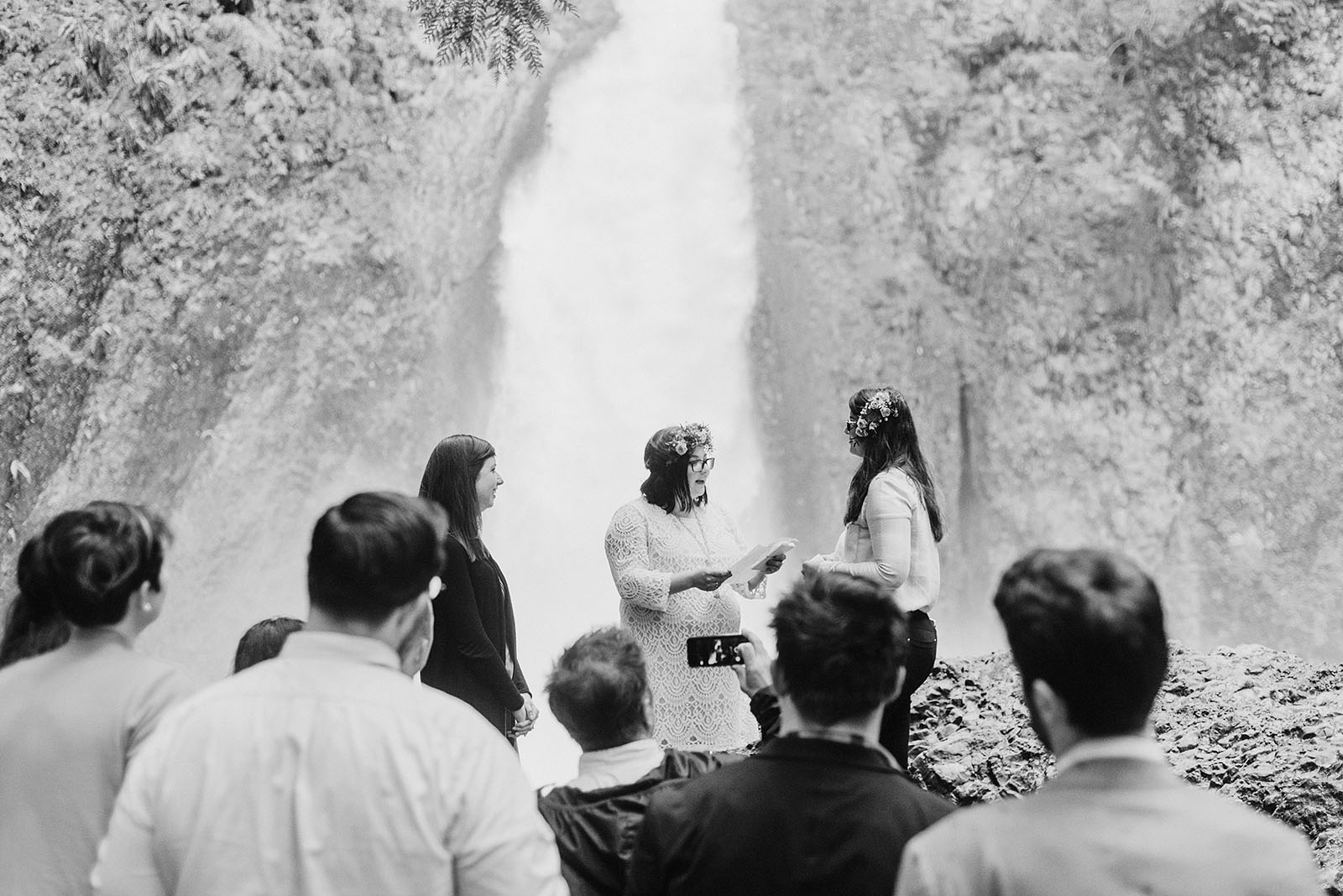 Wedding guests gathered around for the ceremony at a Portland waterfall elopement