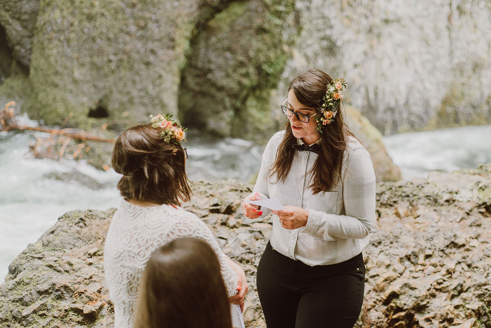 Brides exchanging vows at a Portland waterfall elopement