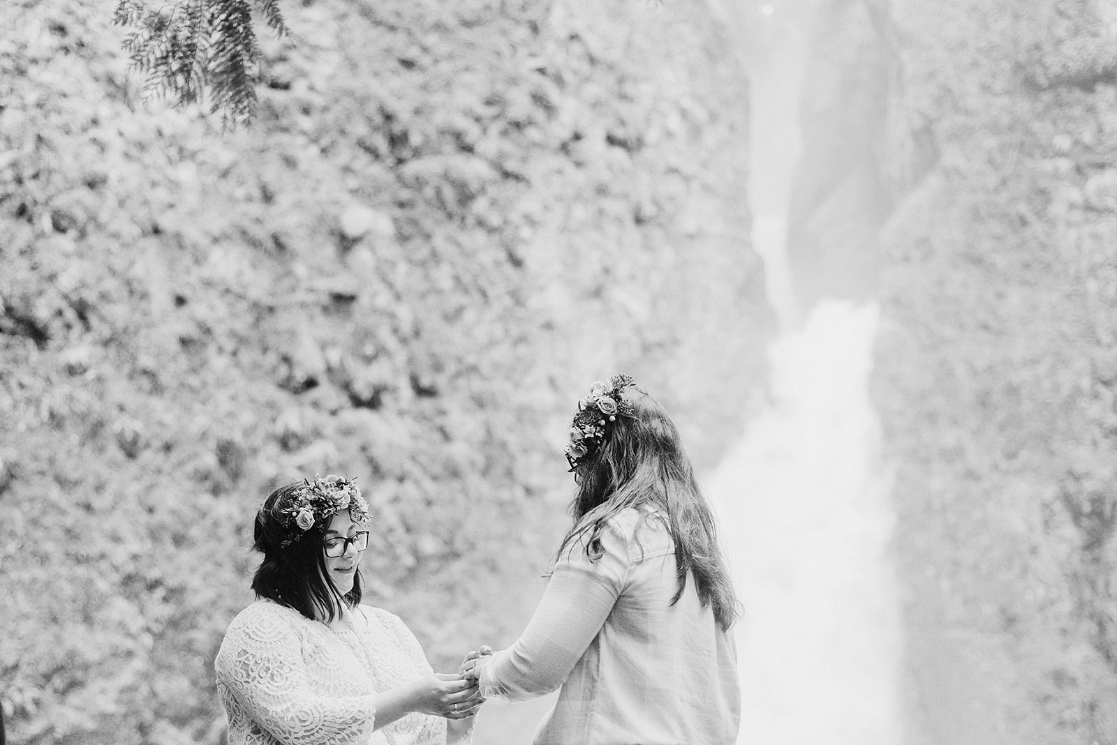 Brides exchanging rings at a Portland waterfall elopement