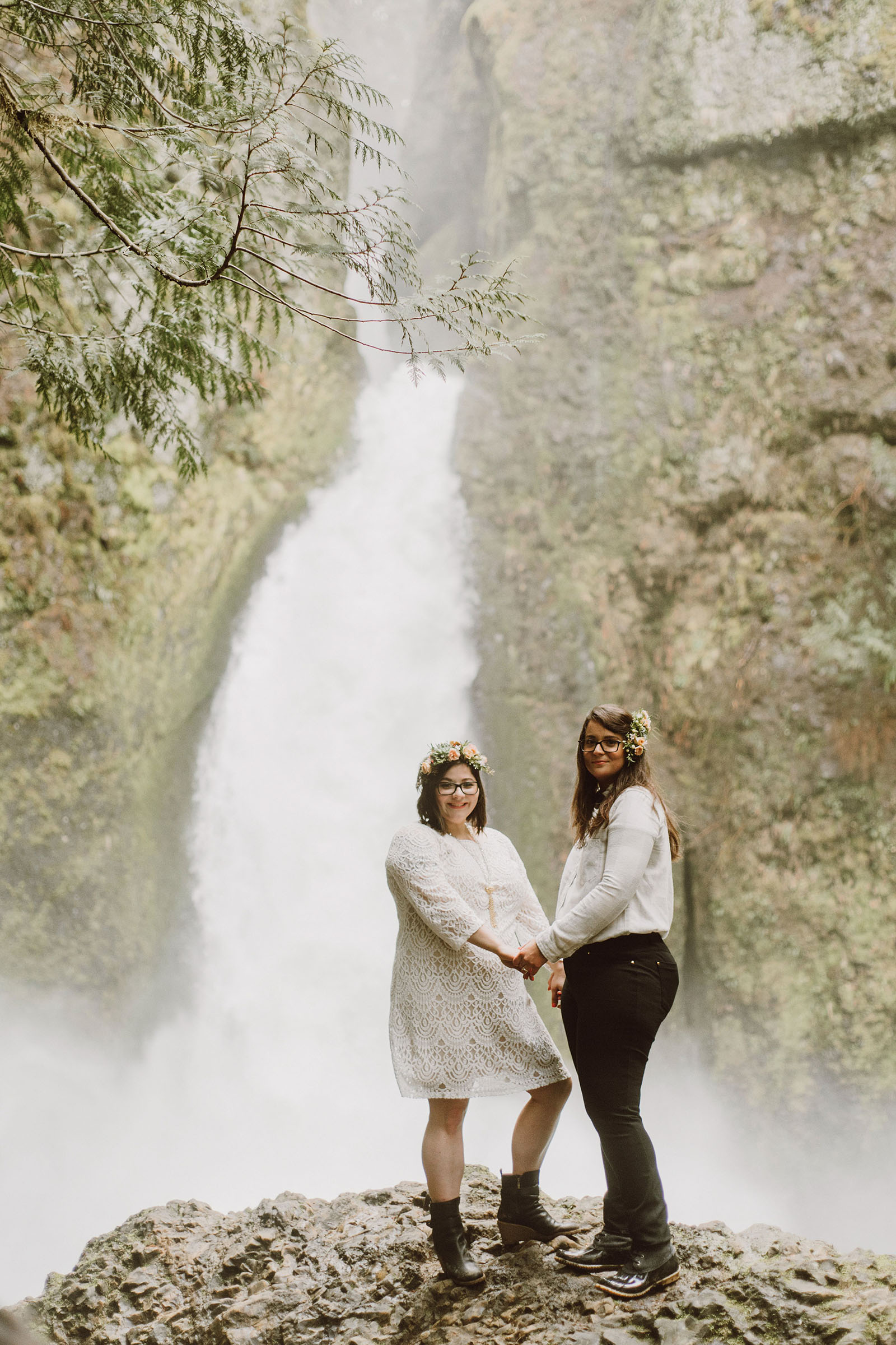 Newlywed couple posing in front of Wahclella Falls at a Portland waterfall elopement