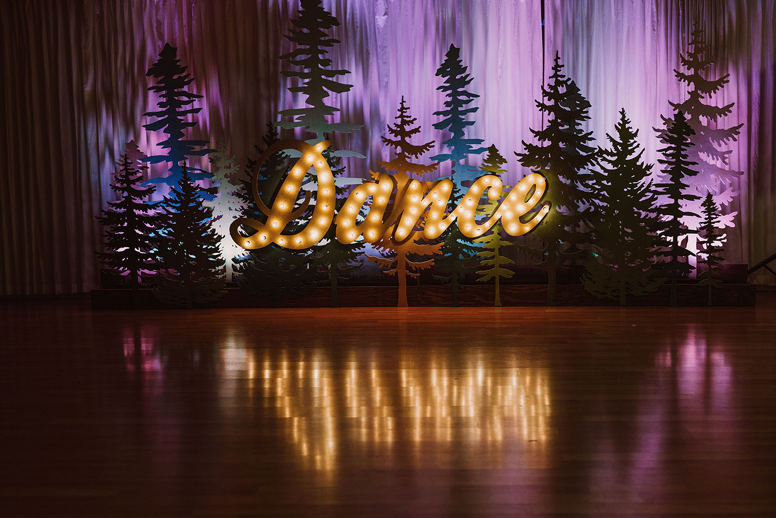 Light up sign on the dance floor at The Colony St Johns Wedding