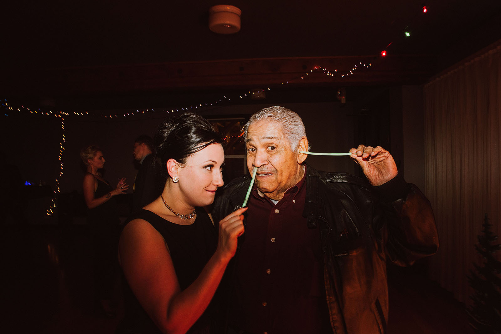 Bride and her grandpa playing with glow sticks at The Colony St Johns Wedding