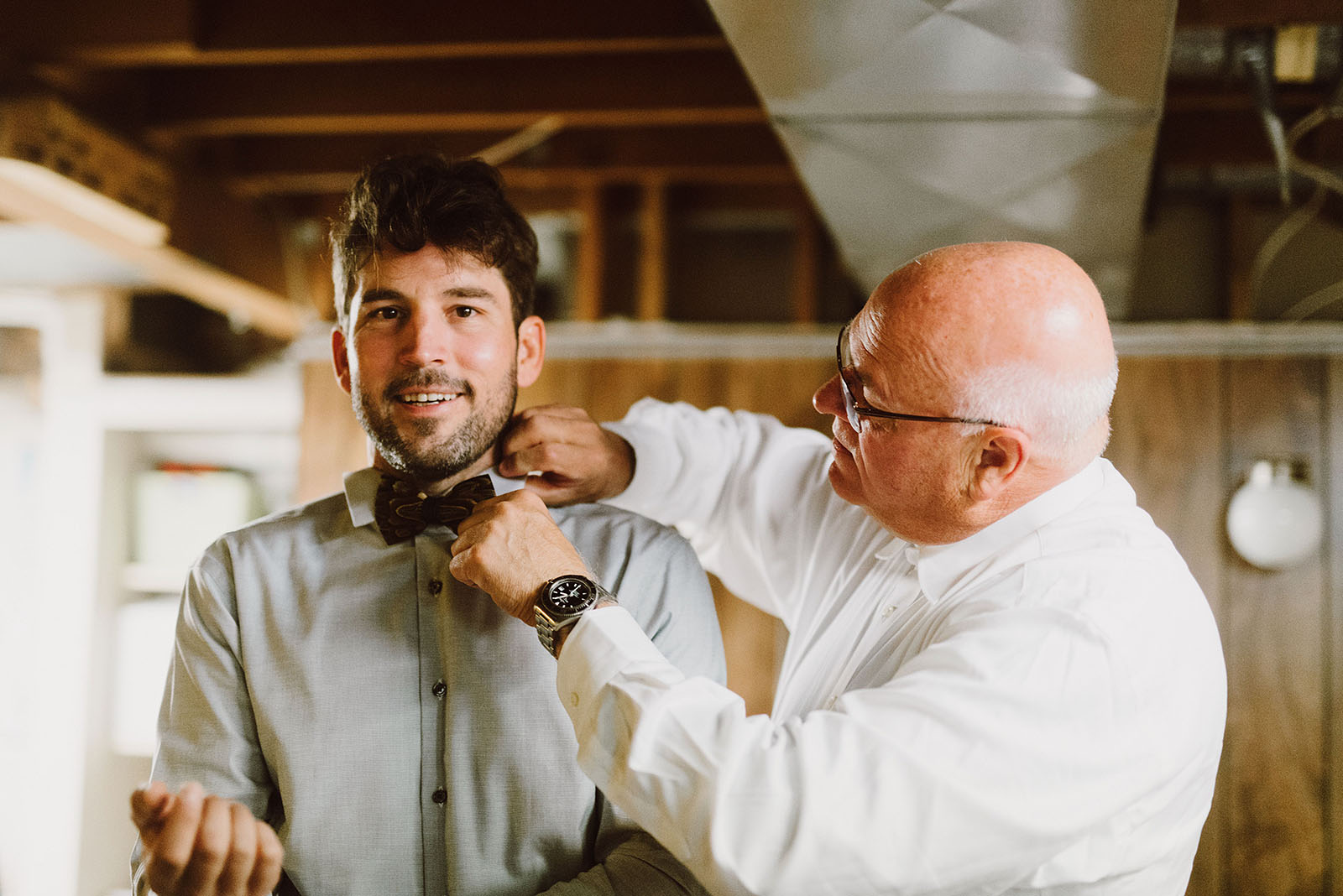 groom's father adjusting his son's tie - portland wedding photography