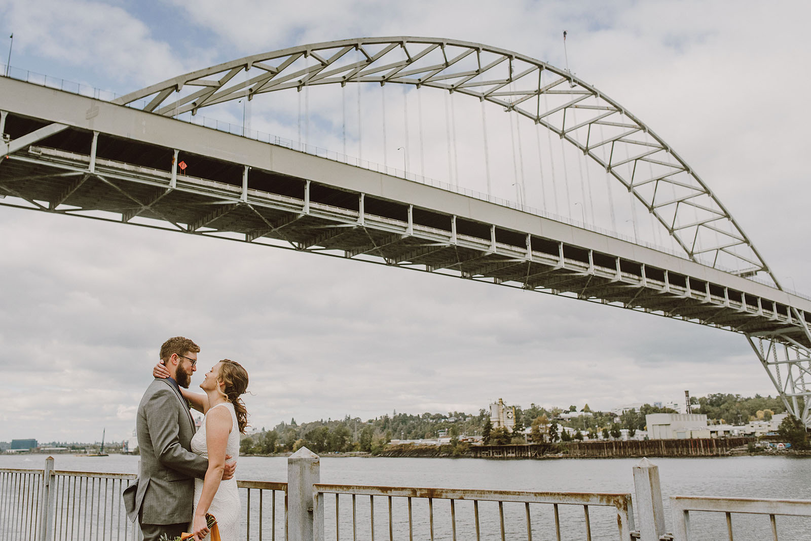 bride and groom's first look under the Fremont Bridge - portland wedding photography