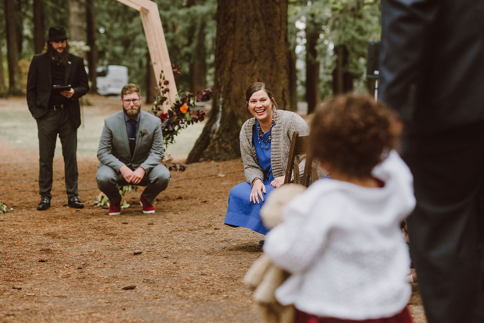 flower girl walking down the aisle on Mt Tabor - portland wedding photography